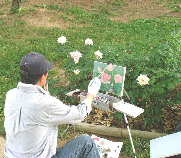 Художник в саду роз Большого парка