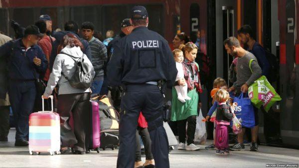 Беженцы и германская полиция