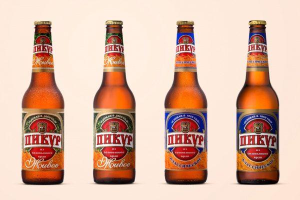 Четыре бутылки пива Пикур